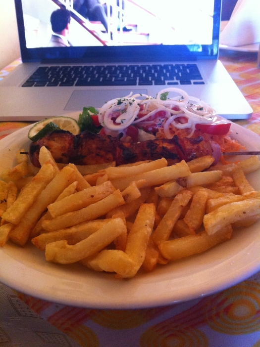 My first solo meal in Huye: fish brochette and chips as they call it here. Had been to Huye twice before and with a group so never ate alone. Gave me time to catch up on Mad Men.