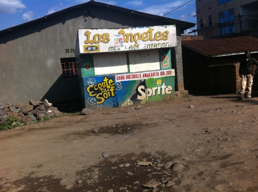 This is a small Naturally, this sign made me miss L.A. I took this same picture during my last trip to Rwanda in July 2011. Came back two years later to see it still standing.